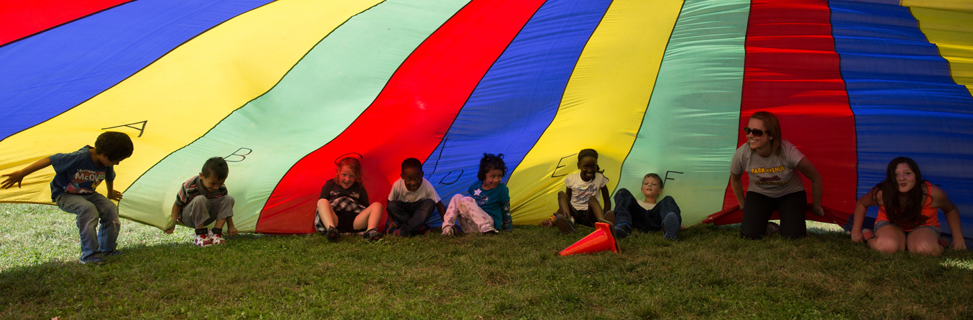 Park Avenue Elementary School Students Playing Under Parachute
